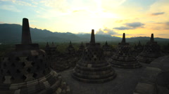 Borobudur at sunset a stone monument a temple to Buddhism Java Indonesia Stock Footage