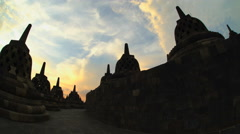 Sunset over Borobudur a religious ruined temple an ancient wonder Indonesia Stock Footage