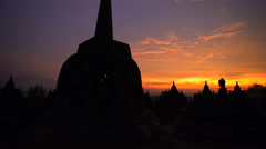 Borobudur at sunrise a stone monument a temple to Buddhism Java Indonesia Stock Footage