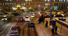 Busy Intersection and traffic light in a big city covered with snow Stock Footage