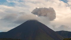 Time-lapse of clouds passing over Reventador Volcano  at dawn.  Stock Footage