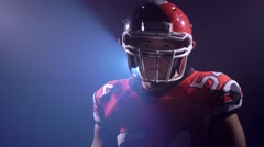 Agressive American football player looking to camera Stock Footage