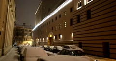 Winter night in a big city, fluffy white snow Stock Footage