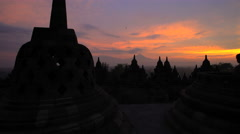 Mt Merapi and Borobudur at sunrise a temple to Hinduism Java Yogyakarta Stock Footage