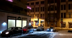 Roadway quiet streets, the snow, the buildings are illuminated Stock Footage