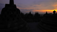 Hindu temple Mt Merapi and Borobudur at sunrise Java Yogyakarta Stock Footage