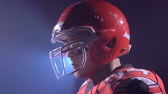Brutal American football player looking to camera Stock Footage
