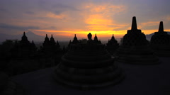 Sunrise view Mt Merapi and Borobudur religious temple Java South East Asia Stock Footage