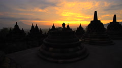 Mt Merapi and Borobudur Hindu temple at sunrise Java Yogyakarta Stock Footage