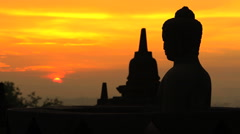 View at sunrise of Borobudur religious temple and monument Java Stock Footage