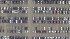 Flying Above Storage Parking Lot of New Unsold Cars, aerial view Stock Footage