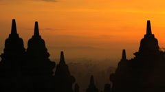 Borobudur at sunrise a religious temple and ancient tourism wonder Indonesia Stock Footage