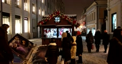 The angle of high-rise building, well-lit street,  winter evening Moscow, snow Stock Footage