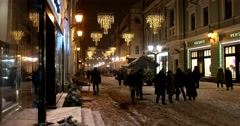 A snowstorm in the night city, festively decorated illuminations of the street Stock Footage