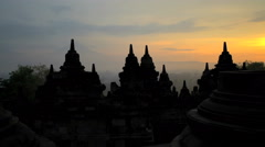 Sunrise view Borobudur religious temple an ancient wonder Java South East Asia Stock Footage