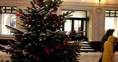 Festively decorated branches of the Christmas tree, under the caps of snow Stock Footage