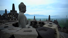 Sunrise over Borobudur a religious ruined temple an ancient wonder Java Stock Footage