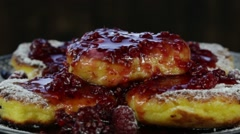 Rotation healthy homemade cheese pancakes with raspberry jam . Close up Stock Footage