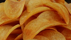 Rotating potato chips close up, macro view food background Stock Footage