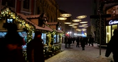 People are rushing to buy gifts, fair winter evening illuminations at night Stock Footage