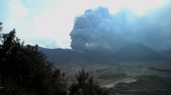 Smoke and ash from Mt Bromo volcano Delta river mud Java Indonesia Stock Footage