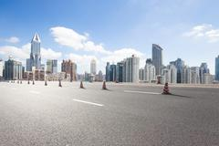 Cityscape and skyline of shanghai from empty road Kuvituskuvat