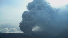 Mt Bromo a remote erupting active volcanic mountain volcano Java Indonesia Stock Footage
