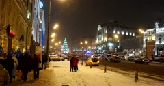 Snowwhite Moscow, snowstorm dazzles  sparkles in  light illumination Christmas Stock Footage