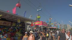 Toronto CNE The Ex Day Fair Crowds Sky Lift Ride Games Festival CN Tower Slow Stock Footage