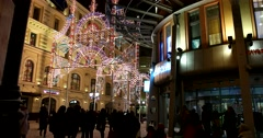 Night before Christmas, festive and crowded on the squares  in winter night Stock Footage
