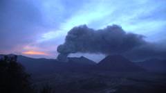Smoke and ash from Mount Bromo volcano Delta river mud Java Indonesia Stock Footage