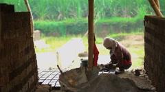 Indonesian poor male manual worker making handmade bricks Java Yogyakarta Stock Footage