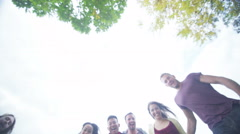 4K Low angle view looking up at happy close group Stock Footage