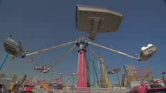 Toronto CNE The Ex Day Fair Crowds Spinning Arm Car Air Ride Festival Slow Stock Footage