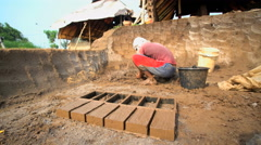 Traditional handmade bricks made by manual workers drying Java Indonesia Stock Footage
