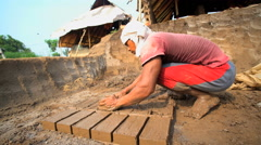 Handmade bricks made by manual workers drying Java Indonesia Stock Footage