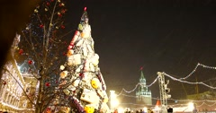 Fabulous Christmas tree on the red square all the lights, wrapped toys and snow Stock Footage