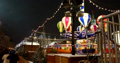 "New year's carousel ""balls"" on the Christmas fair in Moscow playing with lights Stock Footage"