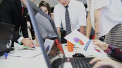 Attractive creative business team brainstorming in a meeting in modern office Stock Footage