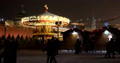 Christmas carousel in the  Kremlin, the snowfall, the snow swirls and lights Stock Footage