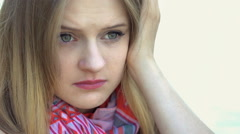 Thoughtful girl being alone and looking very sad, steadycam shot Stock Footage