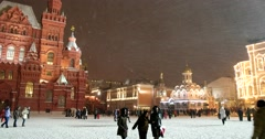 Through heavy snowfall is difficult to see the historical Museum on red square Stock Footage