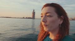 Girl in turquoise dress steer motor boat. Summer sunset. Romantic. Landscape Stock Footage