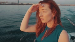Girl in turquoise dress sail on motor boat. Summer sunset. Romantic. Landscape Stock Footage