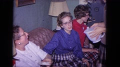 1964: a family christmas indoor party scene is seen Stock Footage