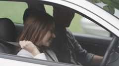4K happy couple kiss in new car Stock Footage