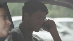 4K happy couple sat in car phoning home to share good news Stock Footage