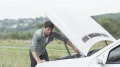 4K Attractive man successfully fixes his car Stock Footage