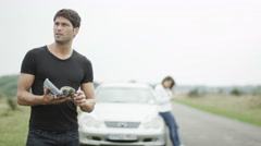 4K attractive man lost with a broken down car at the roadside Stock Footage