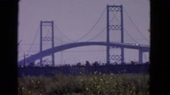 1966: in the movie clip there is a bridge over the river and the river  Stock Footage
